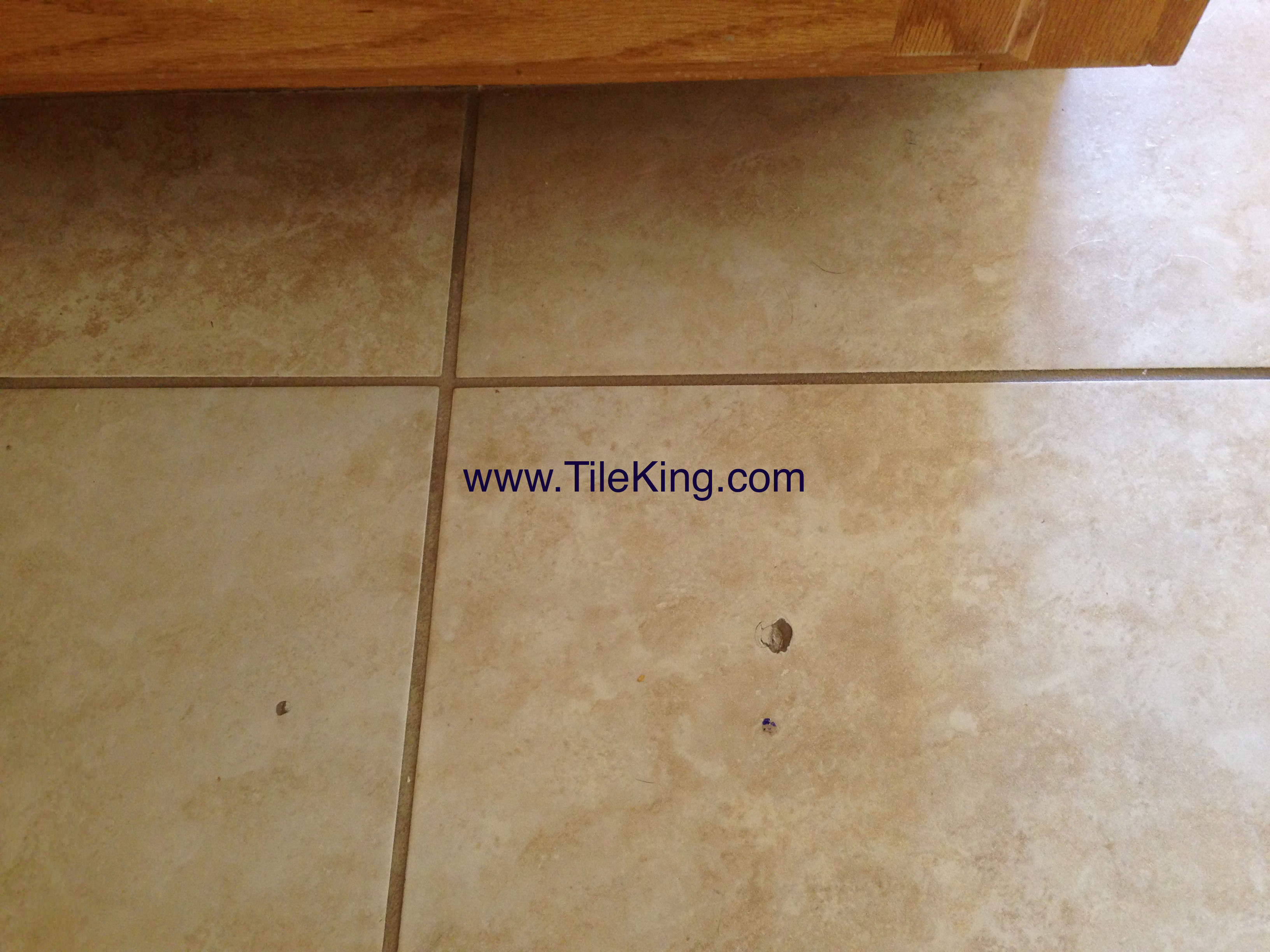 Repairing chipped floor tiles